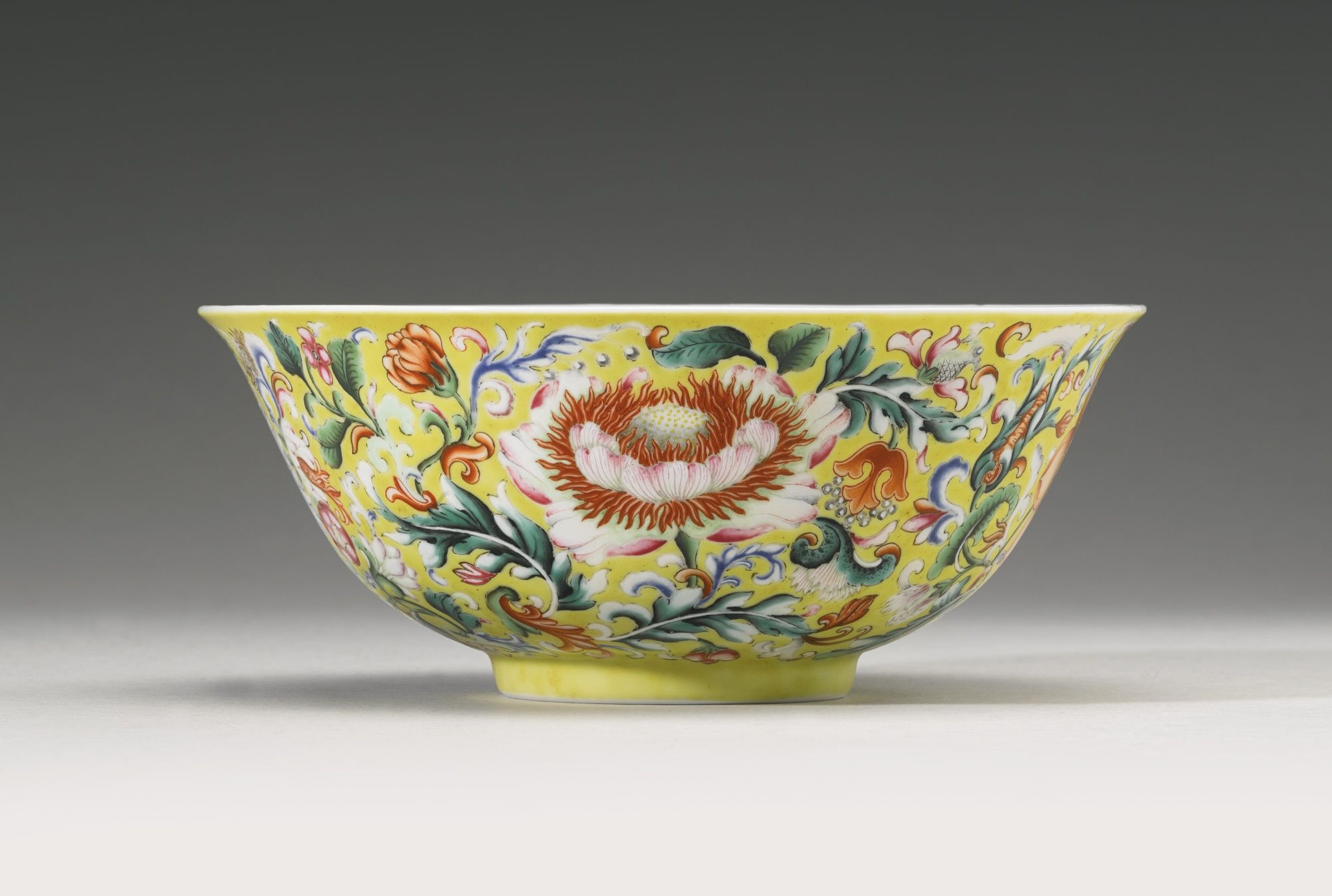 A fine and rare yellow-ground enameled 'Floral' bowl, Qianlong seal mark and period
