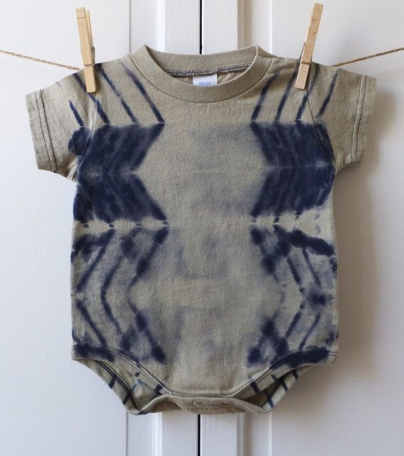 Size 12 month Bodysuit in a bone and navy blue shibori pattern. Hand discharged shibori. Pre-washed with synthrapol and dye-fixing detergent.