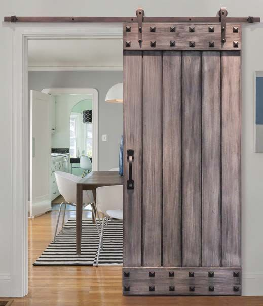 Picture Of This Sliding Barn Door With Exposed Hardware And Studs Makes A Bold Statement In A Mod Sliding Doors Interior Barn Doors Sliding Wood Doors Interior