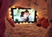 How cute is this cozy den? Create a fortress of duvets and fairy lights