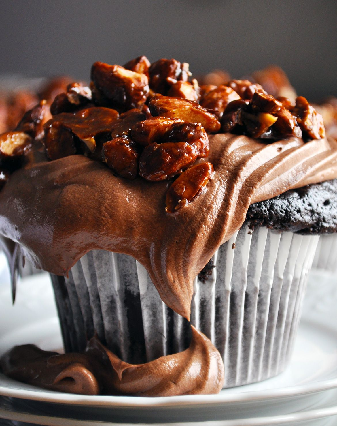 Ultra moist chocolate cupcake recipe with amaretto pastry cream & almond pralines.