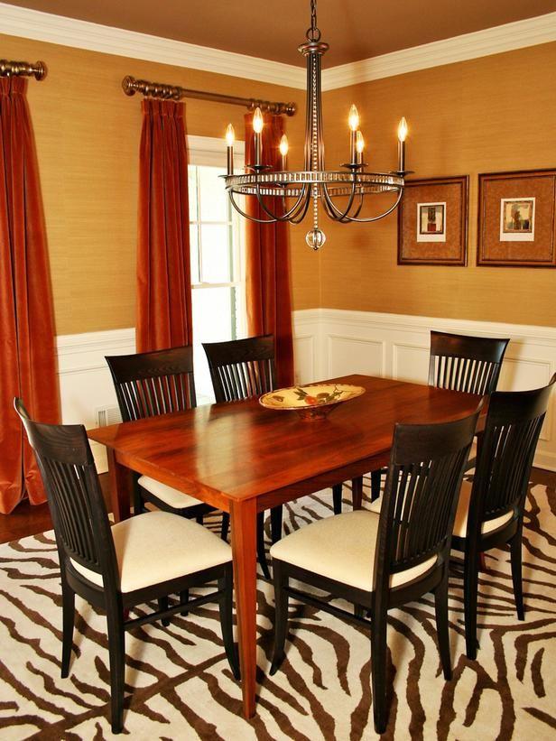 Superbe Warm Red And Gold Dining Room. Old Fashioned Chandelier Balances Modern  Zebra Print.