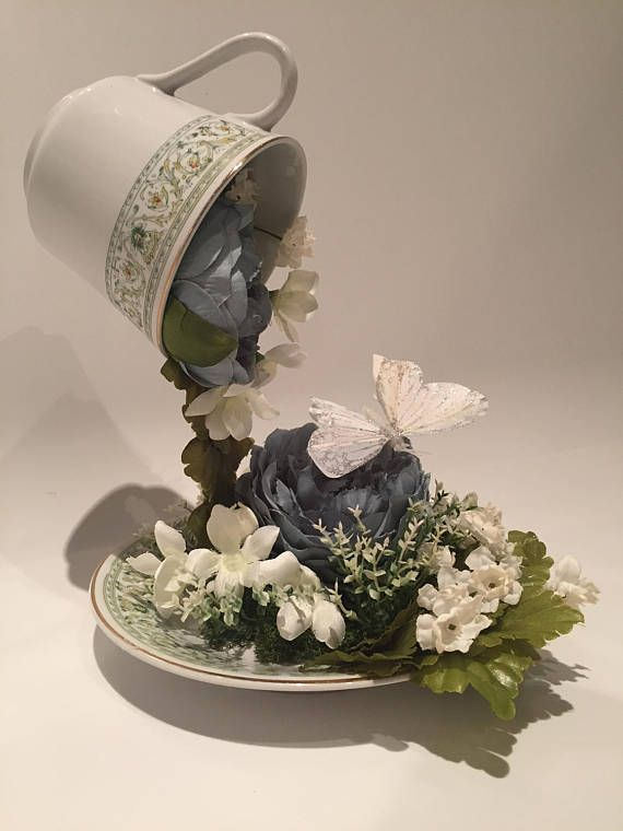 Floating tea cup flowers centerpiece wedding china blue and white unique one off floating tea cup flower arrangement that can be used for weddingbirthdaychristeningeaster celebration the flowers appear to be spilling mightylinksfo