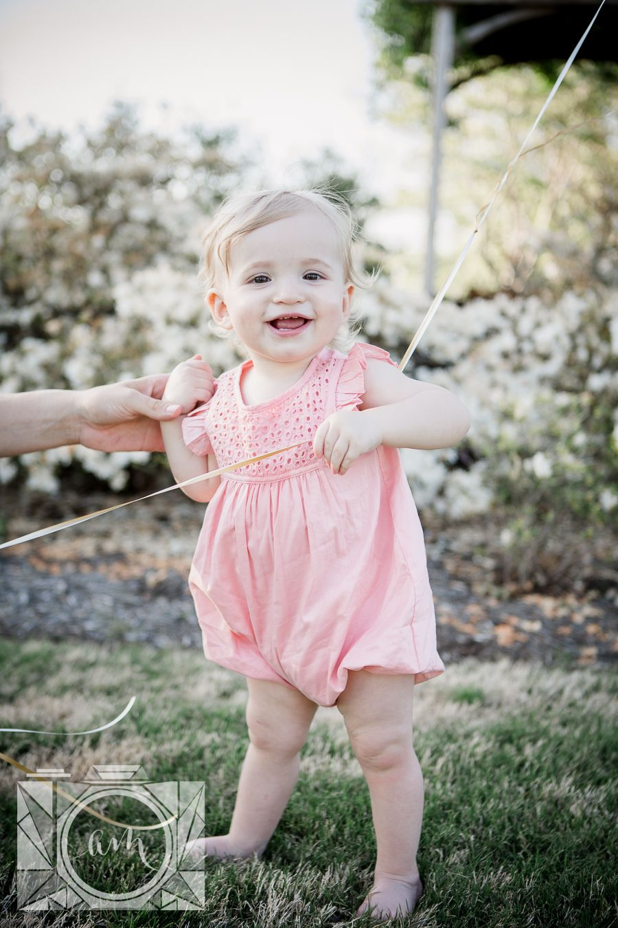 8128fb4d3016f Little girl standing holding onto moms thumb and balloon string at her 1  year old session at Baxter Gardens by Knoxville Wedding Photographer, ...