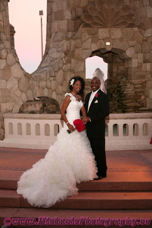 Daytona Beach Hilton Central Florida Weddings Red Wedding Bouquets Orlando Party Rentals Orlando Wedding Red Bouquet Wedding Red Wedding Bride Groom Dress