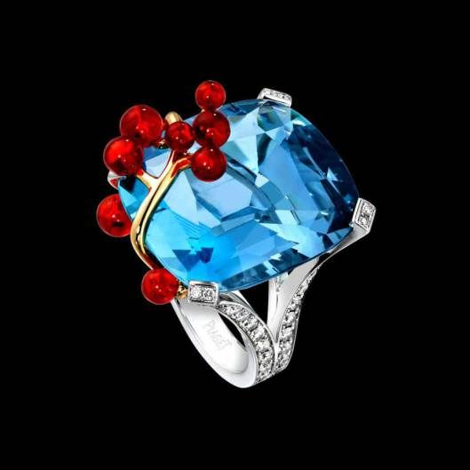 The Limelight Blue Lagoon cocktail inspiration ring from Piaget (white gold, cushion-cut aquamarine, fire opals and brilliant-cut diamonds)