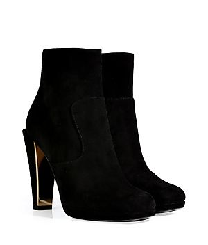A luxe take on this essential style, Fendi's black suede ankle boots feature an edgy square toe and sculptural heel #Stylebop