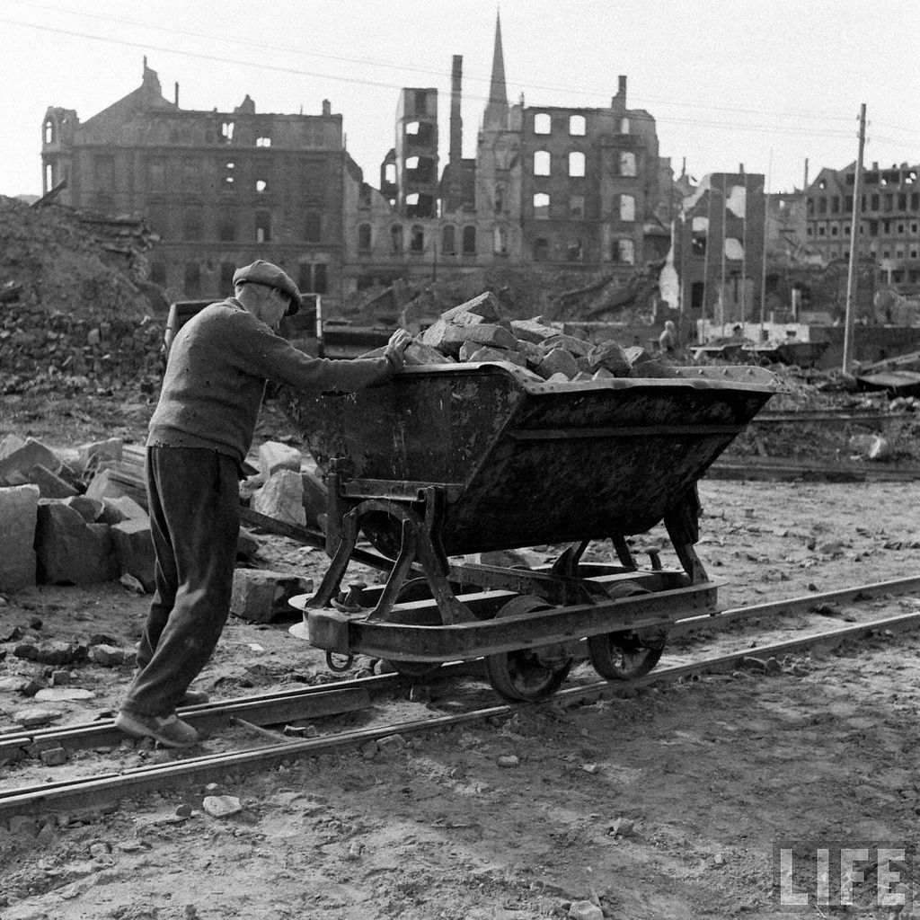 Old man helping to rebuild kassel germany by walter for Germany rebuilding after ww2