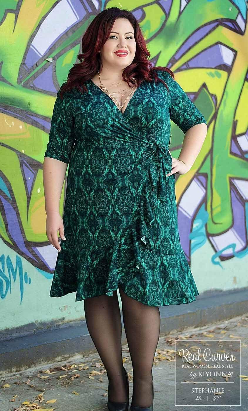 "a24e49a8e6b55 Real Curve Cutie Stephanie (5 7"" and a size 2x) models our plus size Flirty  Flounce Wrap Dress for Canadian boutique Voluptuous. www.kiyonna.com ..."