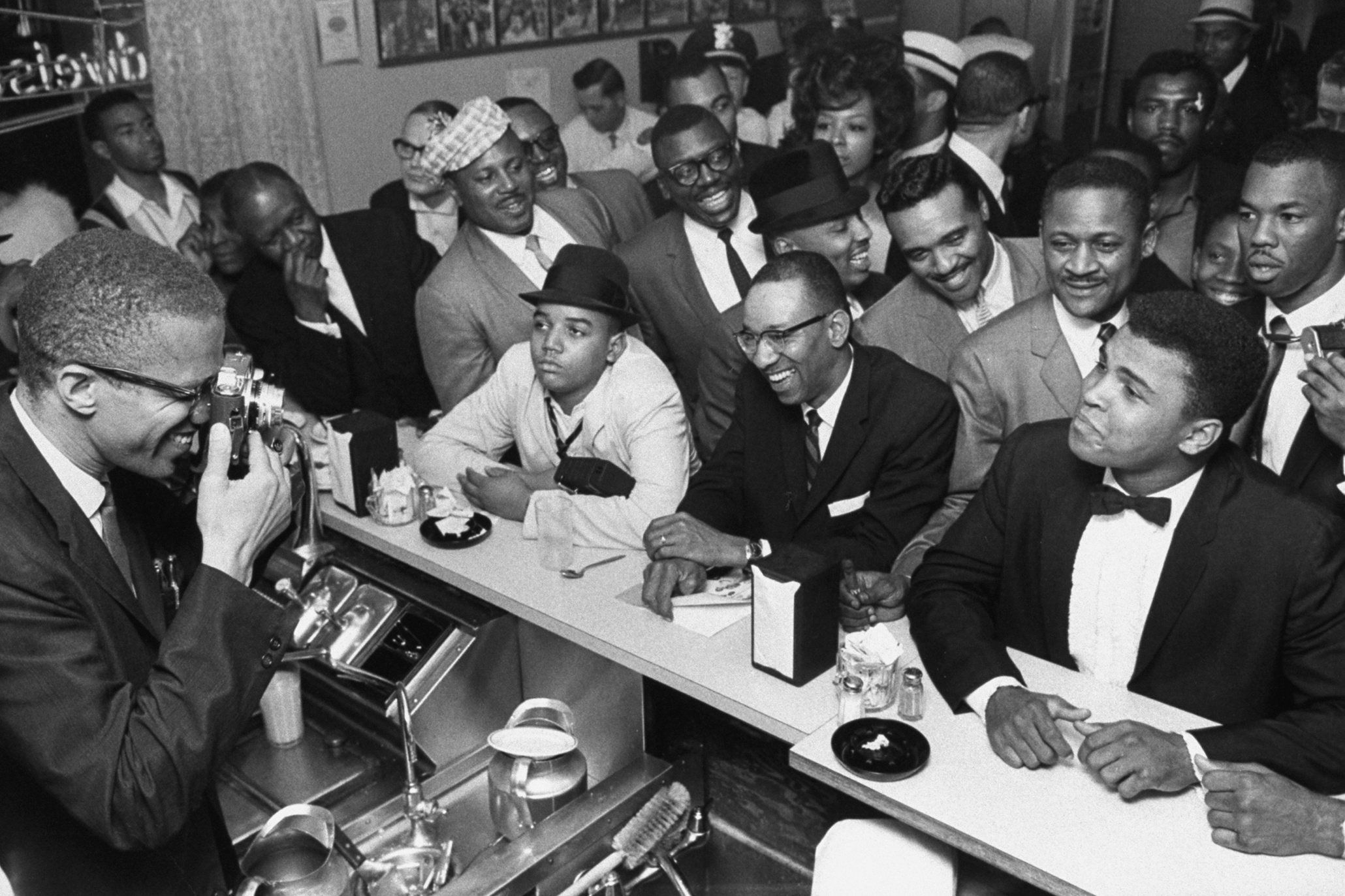 After beating Liston, Clay celebrates with Malcolm X. Rumours had already circulated that Clay had joined the Nation of Islam religious movement, and he finally declared them to be true the day after beating Liston. He changed his name to Muhammad Ali. Photograph: Bob Gomel/The LIFE Images Collection/Getty