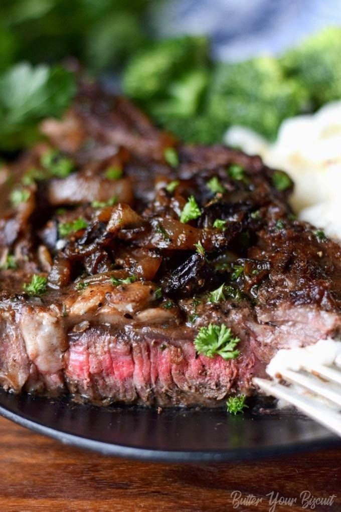 Pan Seared Garlic Rib eye Steak - Butter Your Biscuit #beefsteakrecipe Rib eye steaks are perfectly cooked full of flavor and melt in your mouth tender. Restaurant quality steak you can make at home. #beef #ribeye #steaks
