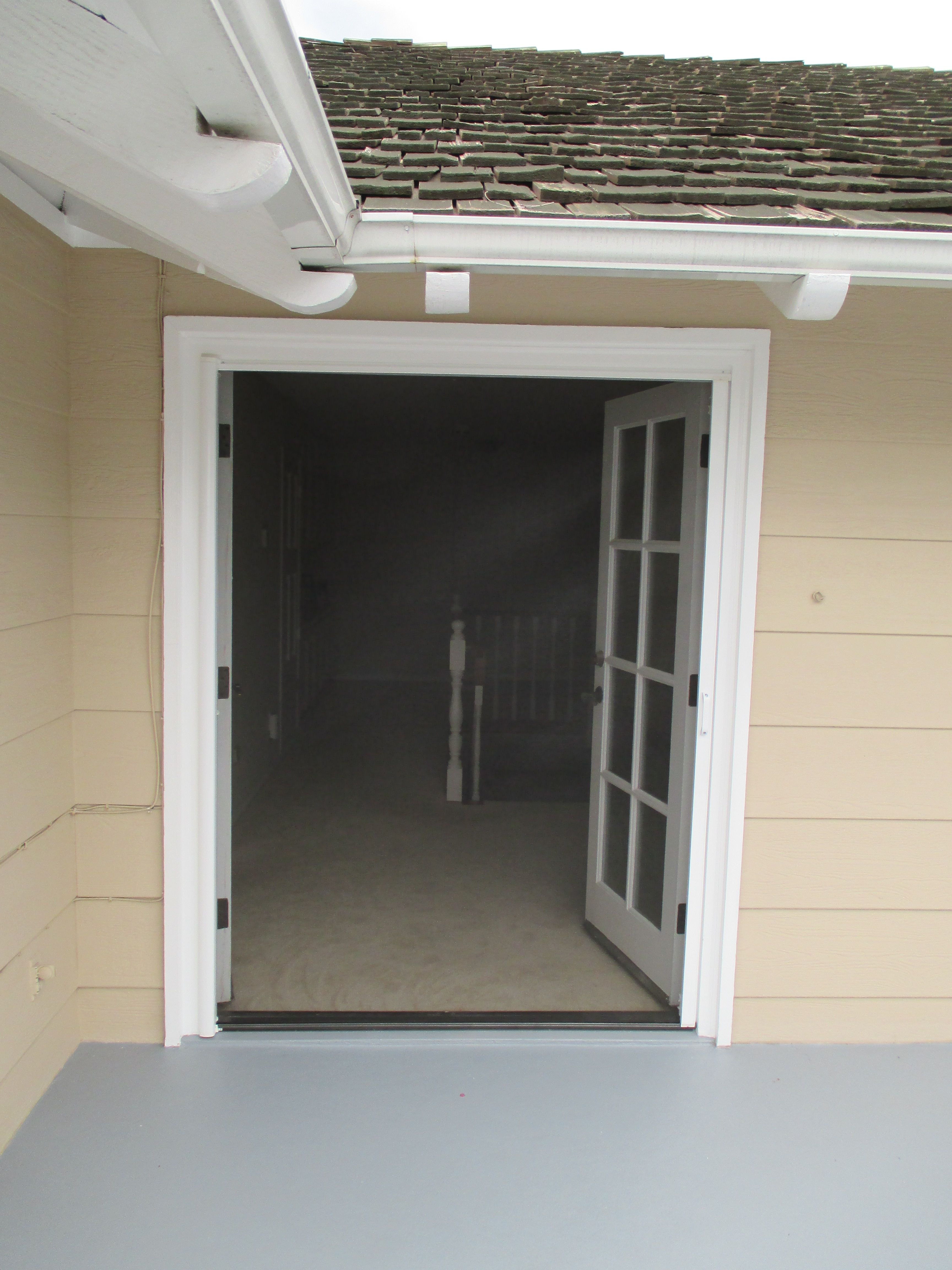 Single Stowaway Retractable Screen Door Pulled Across A Double Door