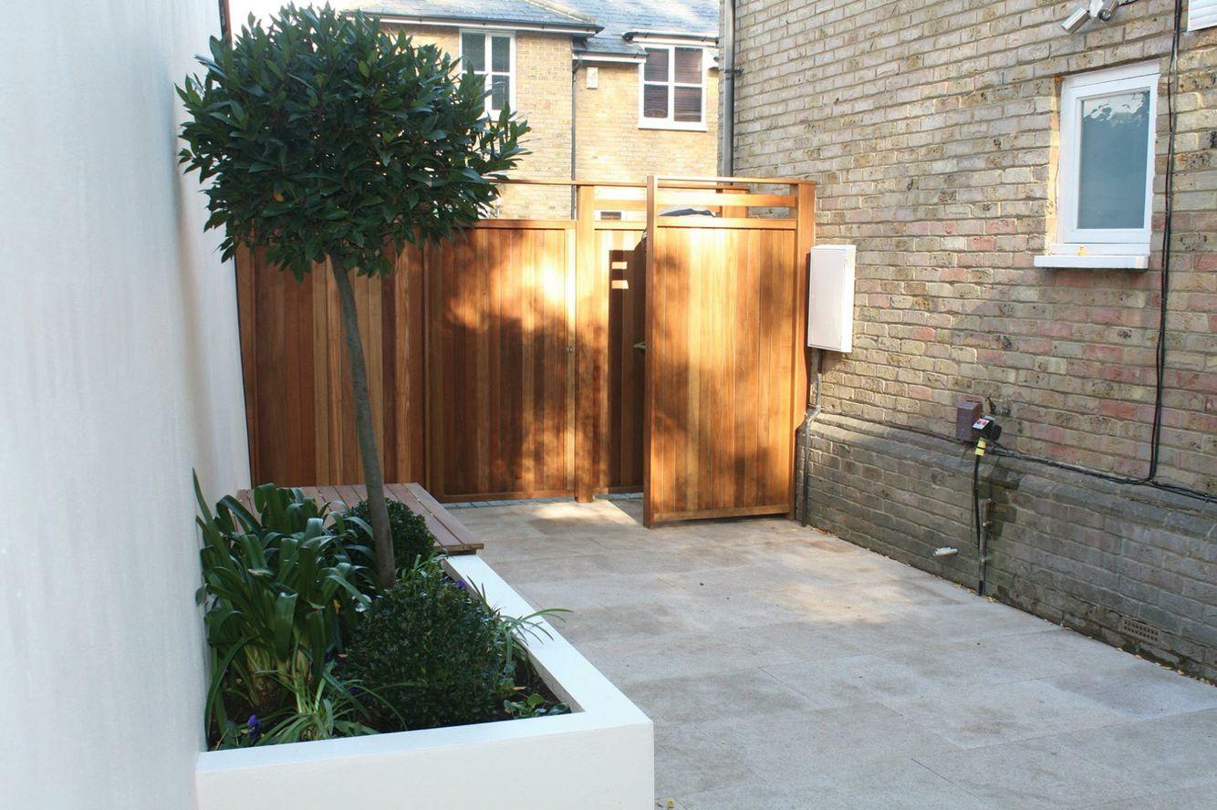 White/planters/fence/paving/urban