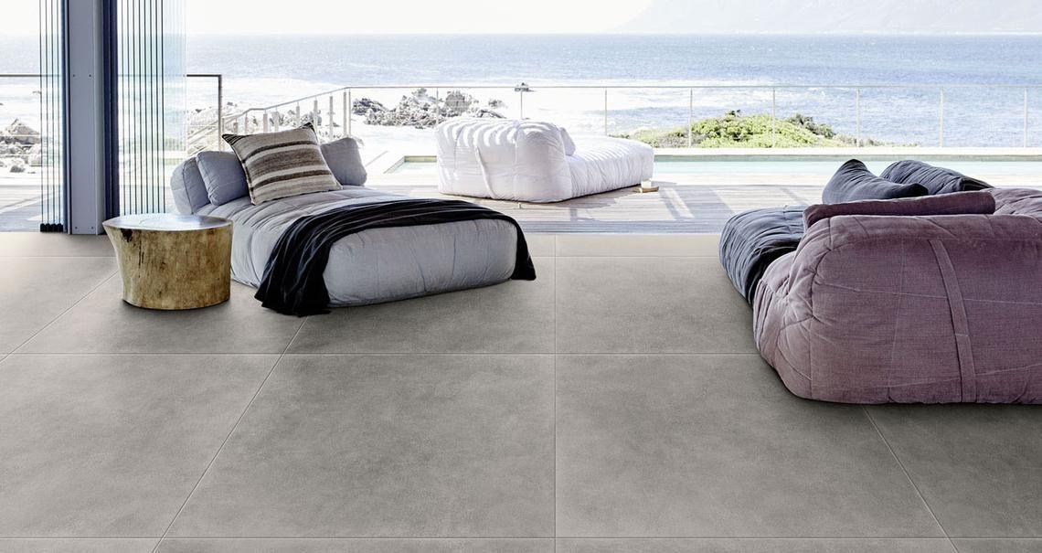 Material effetto cotto e cemento esterni sala in