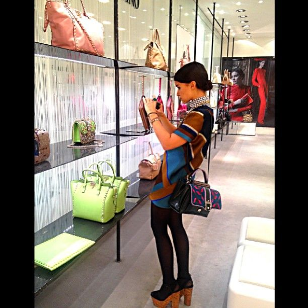 Miroslava Duma snapping pics of Valention bags... that bejeweled one is gorgeous!