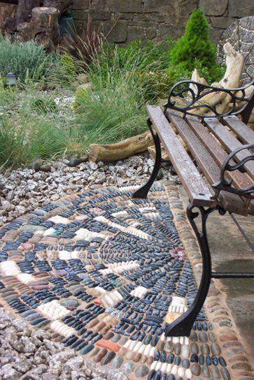 Pebble mosaics in a small garden, Lancaster, Lancashire