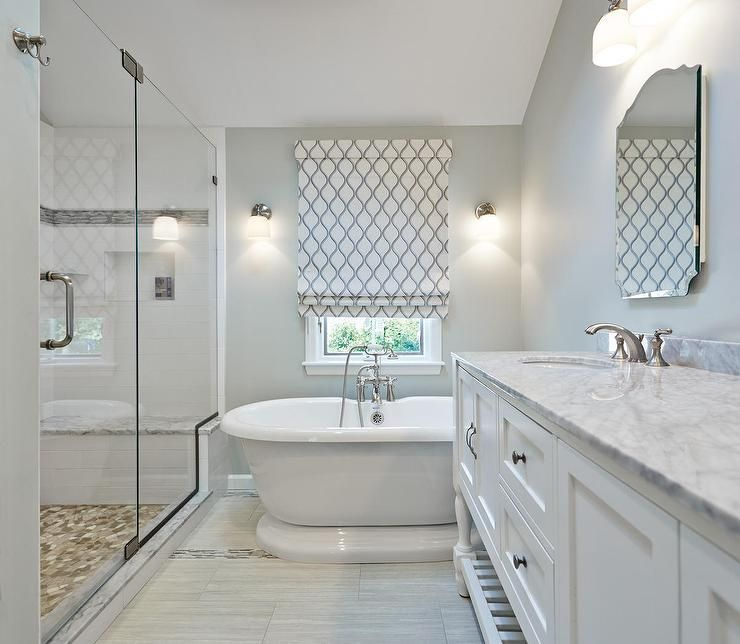 Master Bathroom Shower Boasts White Subway Tiles Accented With Gray Mosaic Border Alongside A Marble