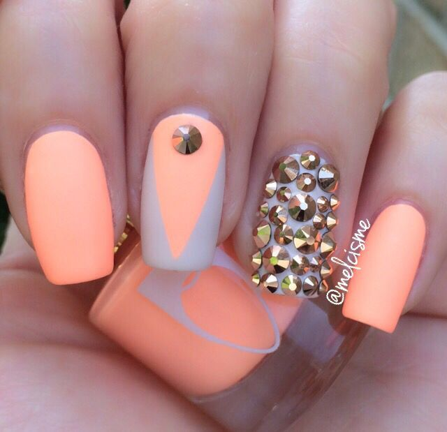 matte neon peach nails with studs