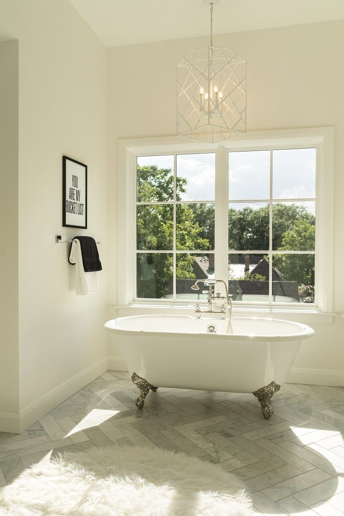 The master bathroom with original clawfoot bathtub. Photo by David ...