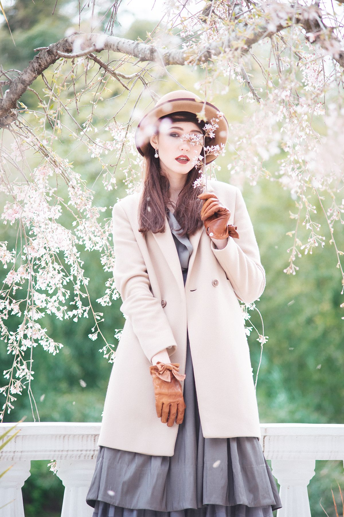 Spring portrait photosession. Vintage style, outfit. Flowers and beauty