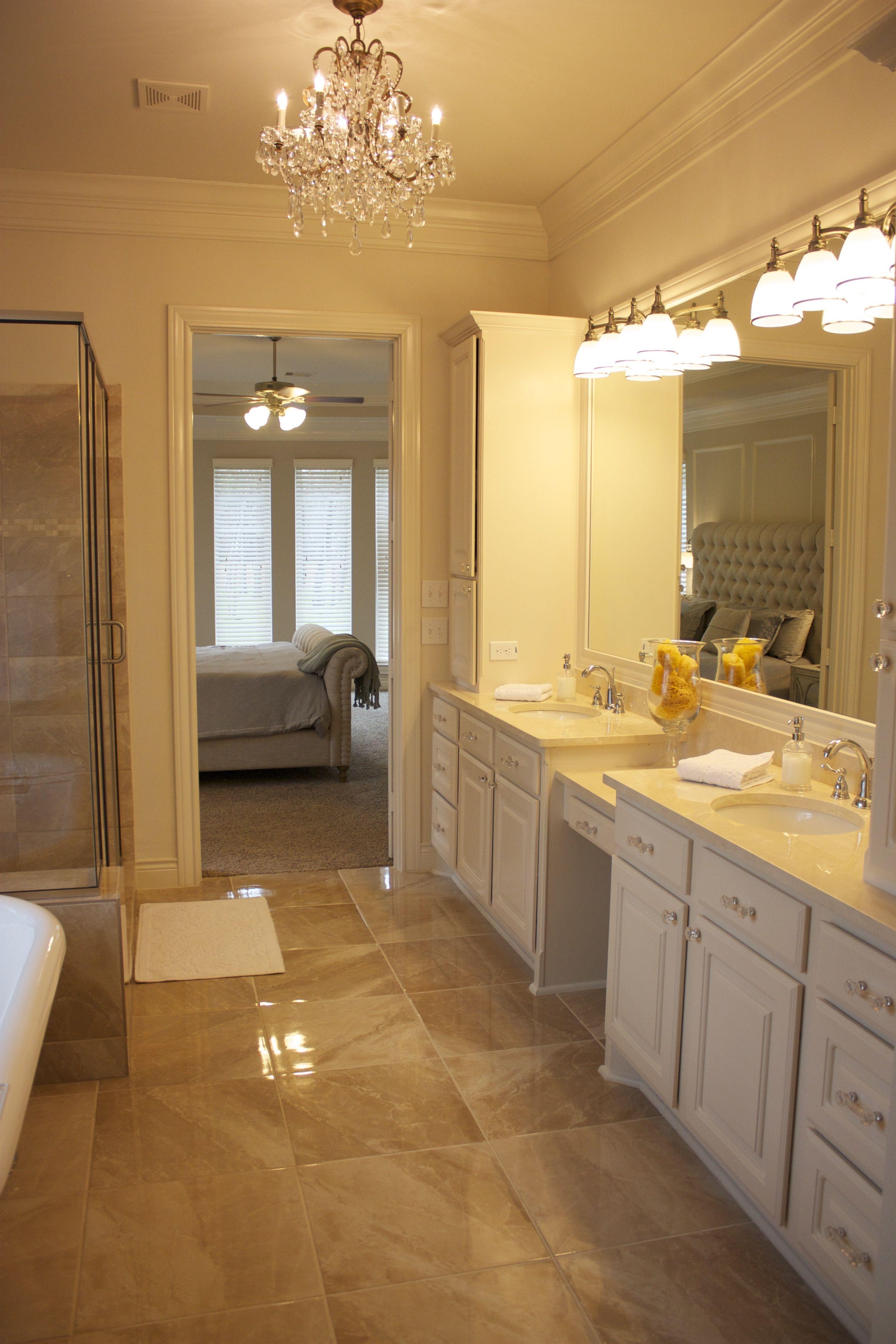 Master bath sherwin williams accessible beige walls off white trim divine white cabinets crema marfil marble countertops restoration hardware