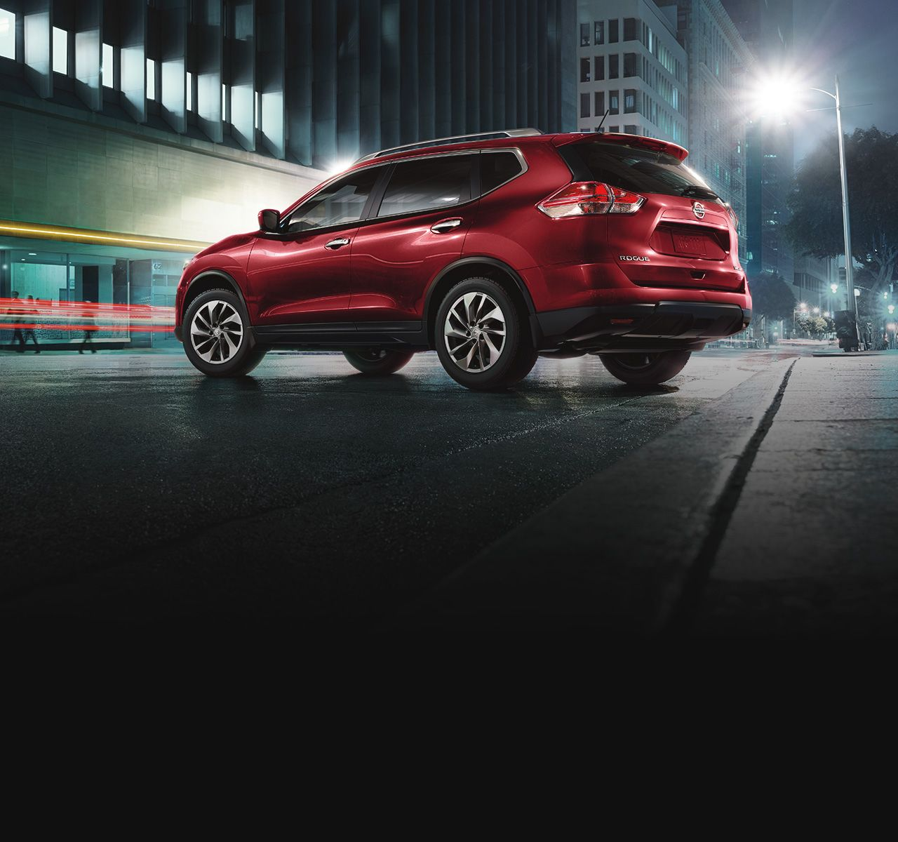 Nissan Rogue SL AWD rear side profile shown in Cayenne Red