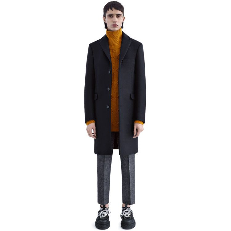 Acne Studios Garret black is a heavy melton coat with a less fitted silhouette.