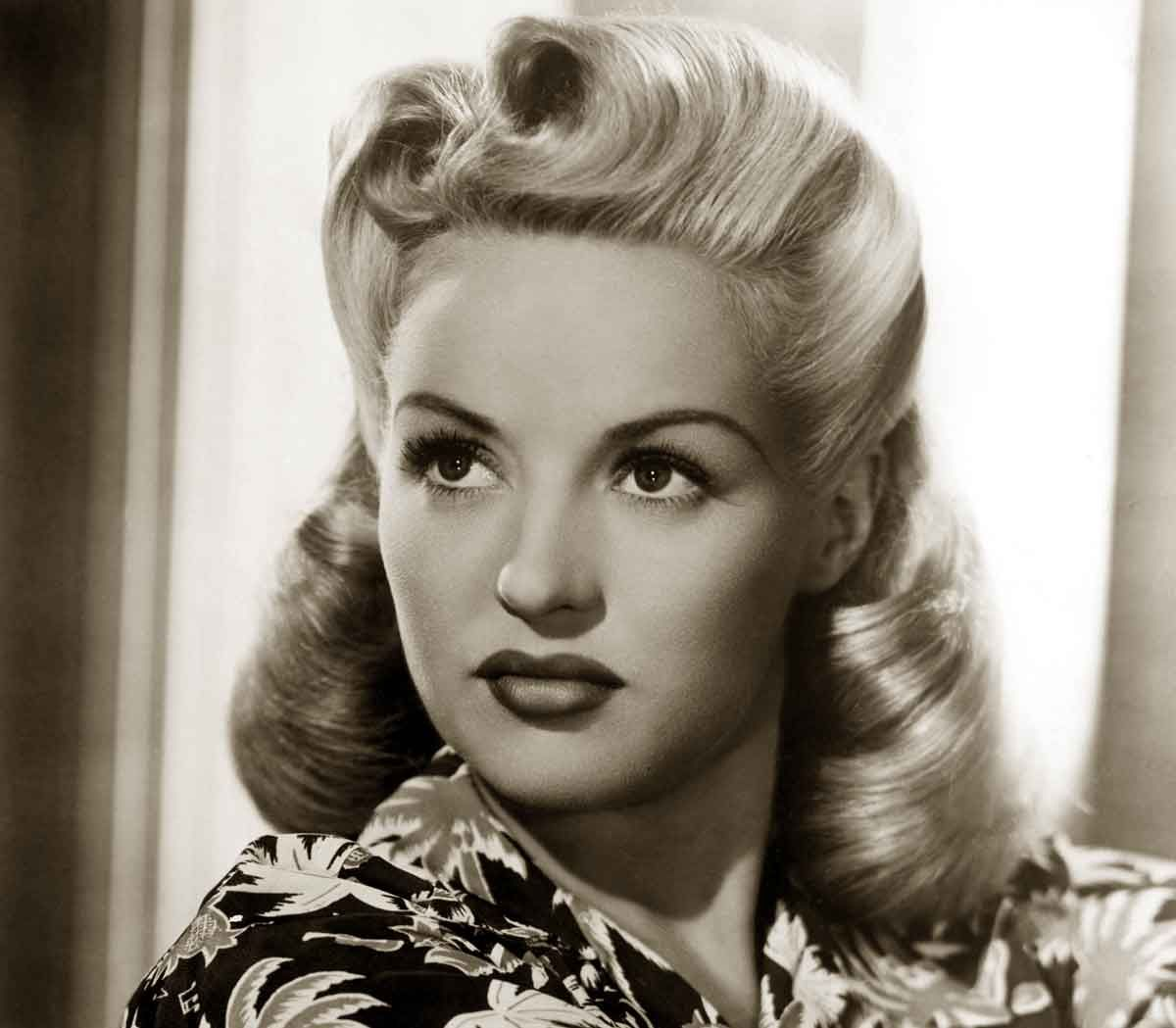 "1940S Hairstyles 1940's Hairstyle Contained Rolls Curls And Waves ""pinup Style"