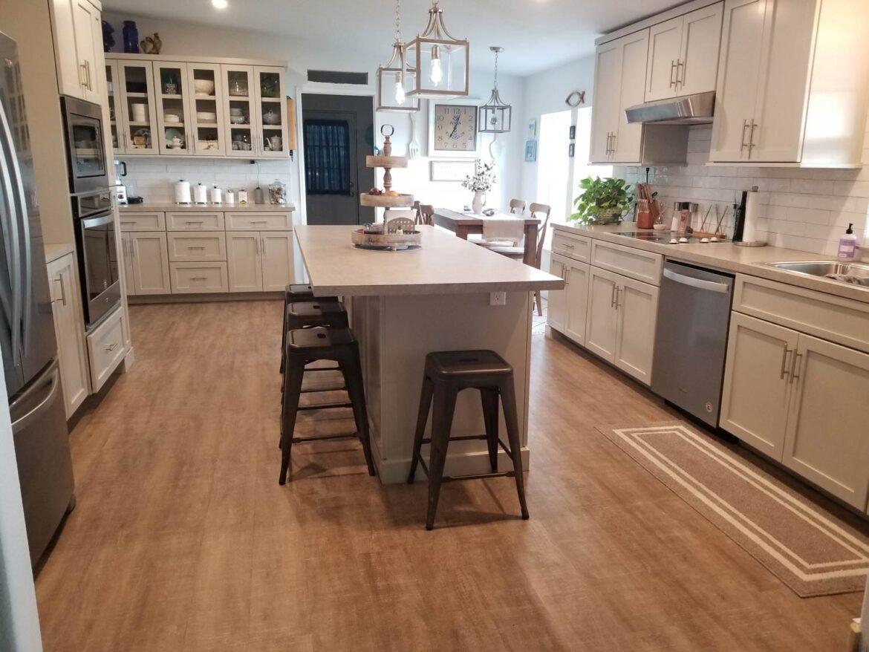 farmhouse kitchen with coretec plus 7 nantucket oak vinyl flooring in 2020 vinyl flooring on farmhouse kitchen tile floor id=99198
