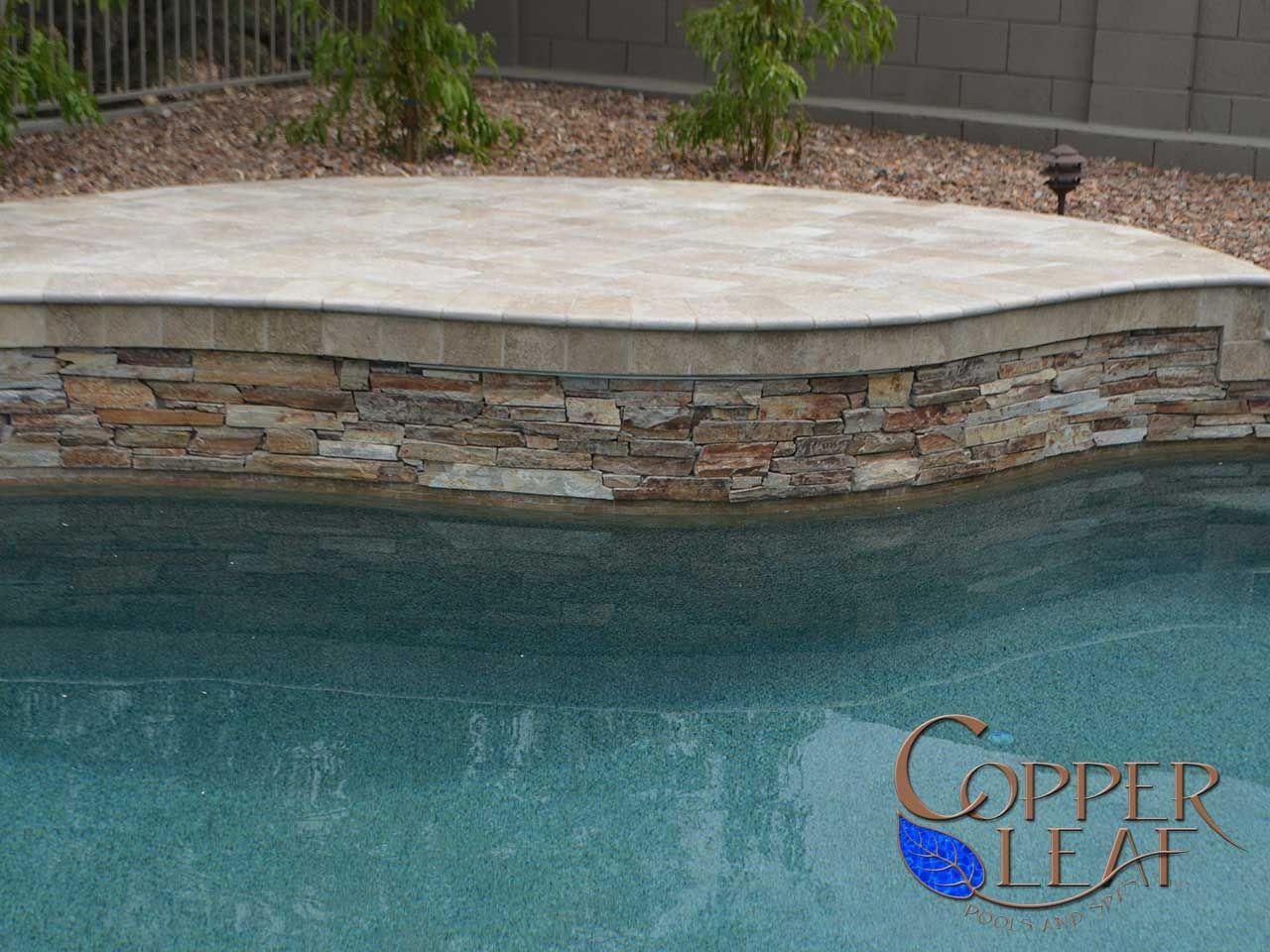 Raised wall mt moriah ledgestone on water feature wall for Raised pool ideas