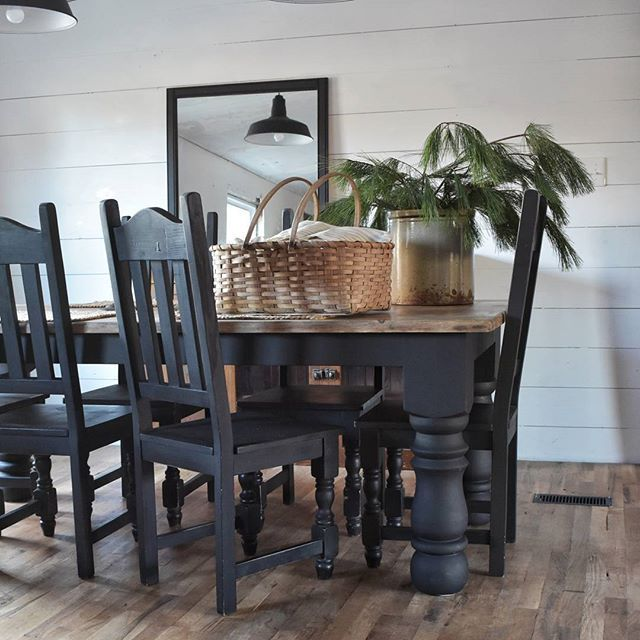 Rustic Farmhouse Dining Room. Black and brown table with white