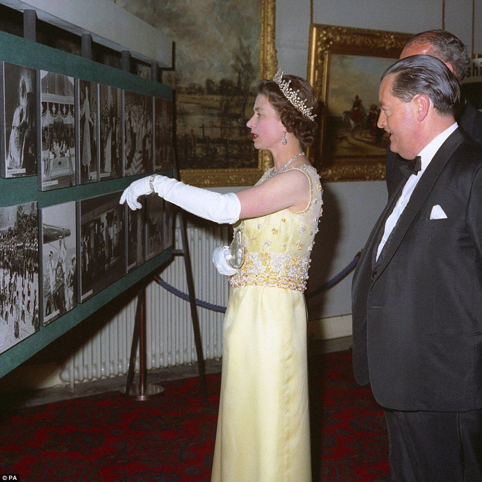 Glamorous:  Queen Elizabeth II and PA Chairman W.D. Barnetson looking at a collection of R...