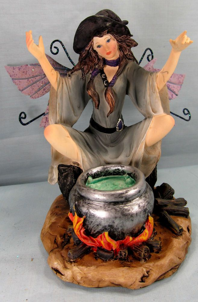 Witch fairy with hot cauldron of potions.
