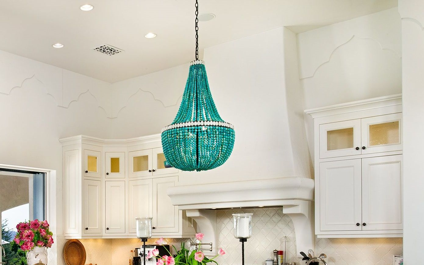 Amazing Kitchen With Turquoise Beaded Chandelier Over Island White Marble Countertop And Prep Sink