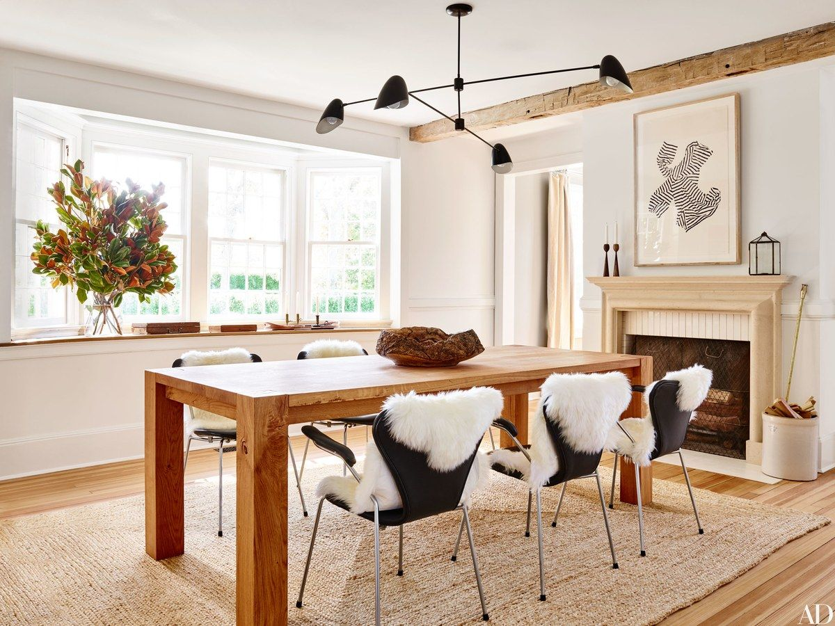 In the dining room a crate and barrel table is surrounded by