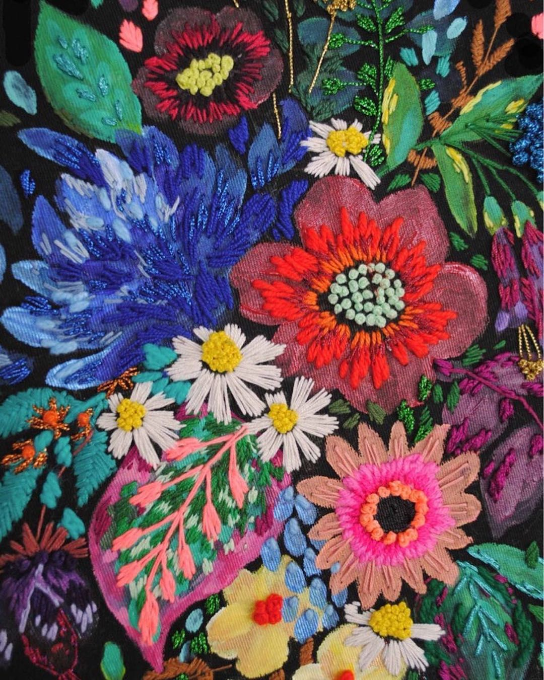 Lush floral art created with a fusion of paint and stitches