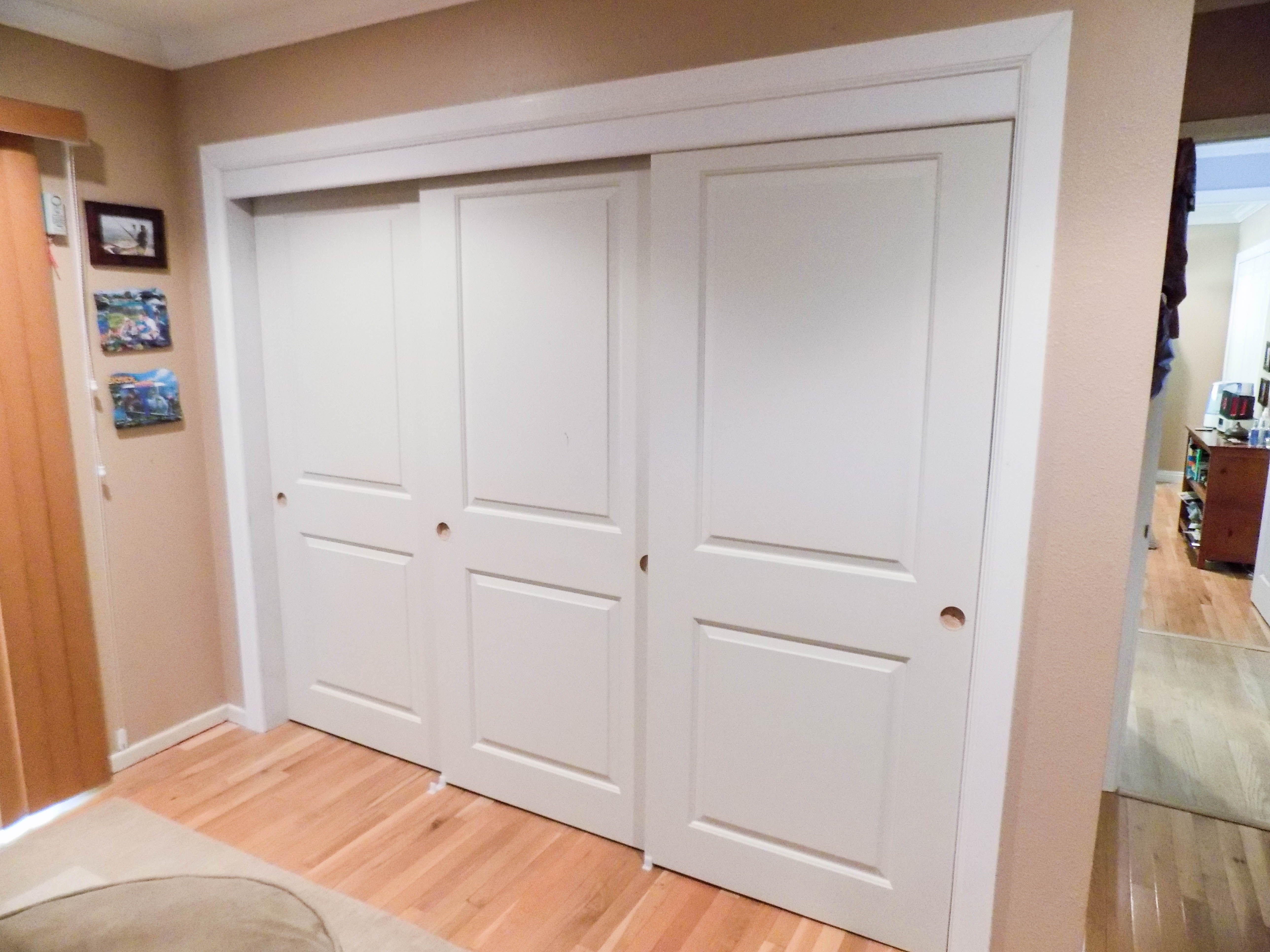3 Panel 3 Track Top Hung Hollow Core Bypass Closet Doors We Install Closet Doors In Cities Like Rancho Santa Margarita Closet Doors Tall Cabinet Storage Home
