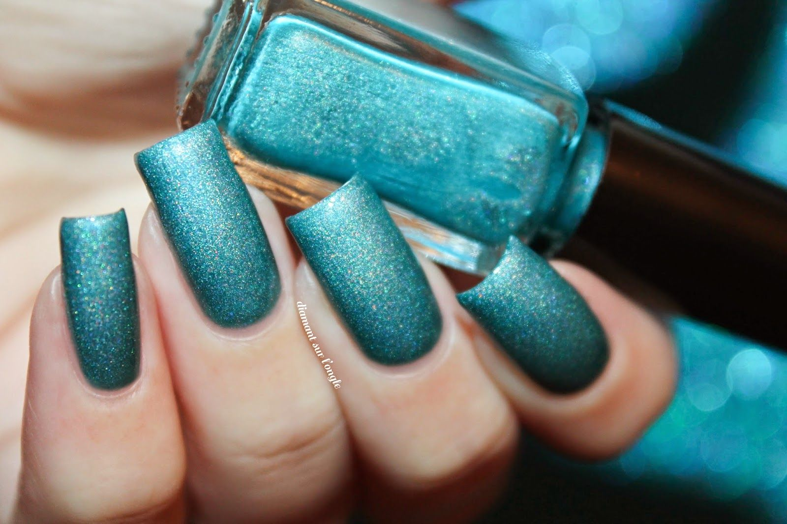 Swatch of a teal holographic franken nail polish by diamant sur l ...