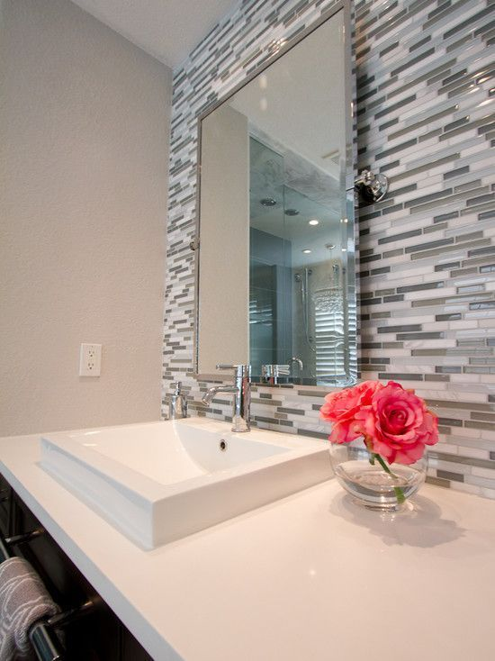 Petruzzi master bathroom white quartz counter tops vessel sinks chrome faucets linear glass tile pivot style mirror also
