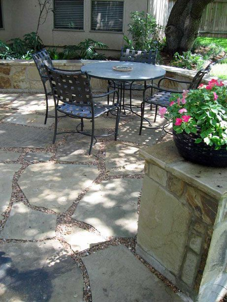 Flagstone Patio With Seat Wall Pea Gravel Used As Grout For Permeable Surface Visit Www