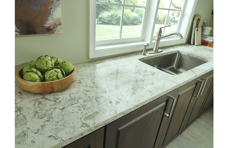 Romano White Quartz Countertop With Dark Cabinets And Wood Grain Tile Floors
