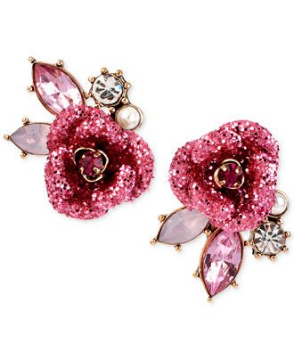 Glittering red roses capture your attention in these stud earrings from Betsey Johnson. Crystals, faceted beads and plastic pearls add to the allure. Crafted in gold-tone mixed metal. Approximate diam
