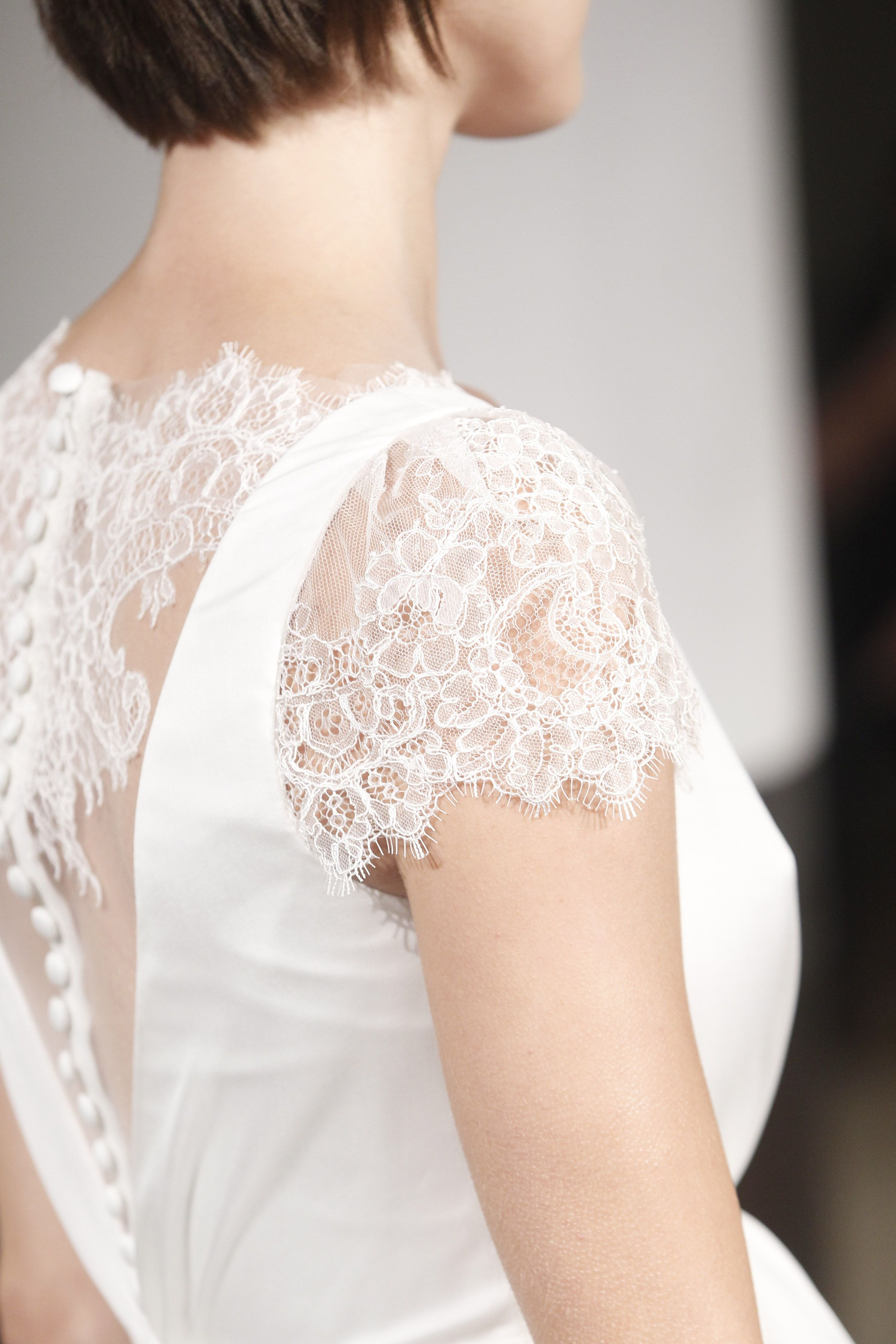 Lace cap sleeve wedding dress from Emma & Grace Bridal Studio || See ...