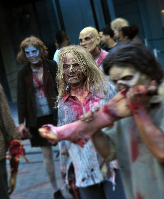 """HHN 22, Universal Studios Florida    A mob of """"walkers"""" descends on the crowd in Halloween Horror Nights 22′s """"The Walking Dead"""" scarezone.    Photo byHHNinPhotographs."""