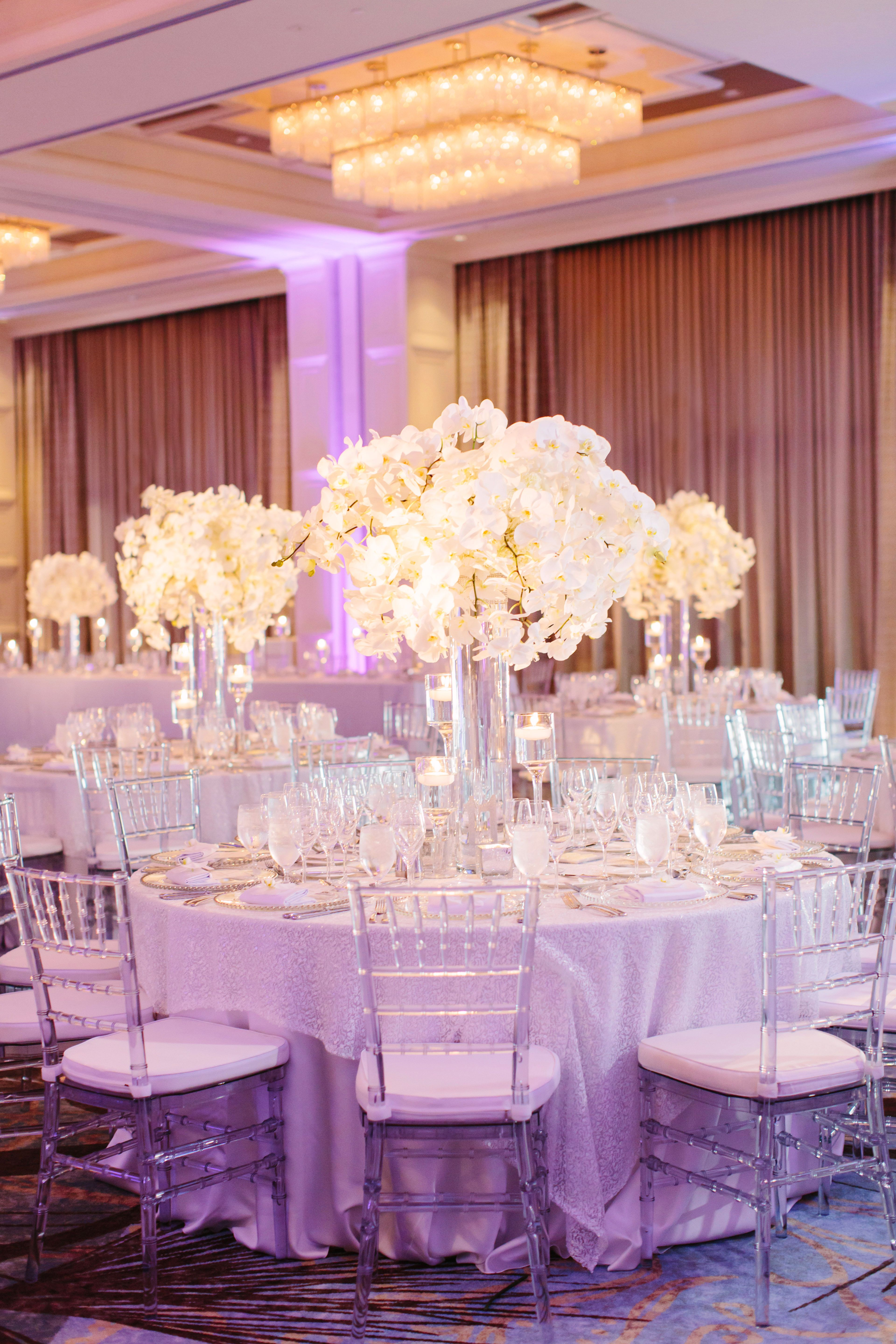 The Couple Decorated Their Reception With Frosted And Clear Glass