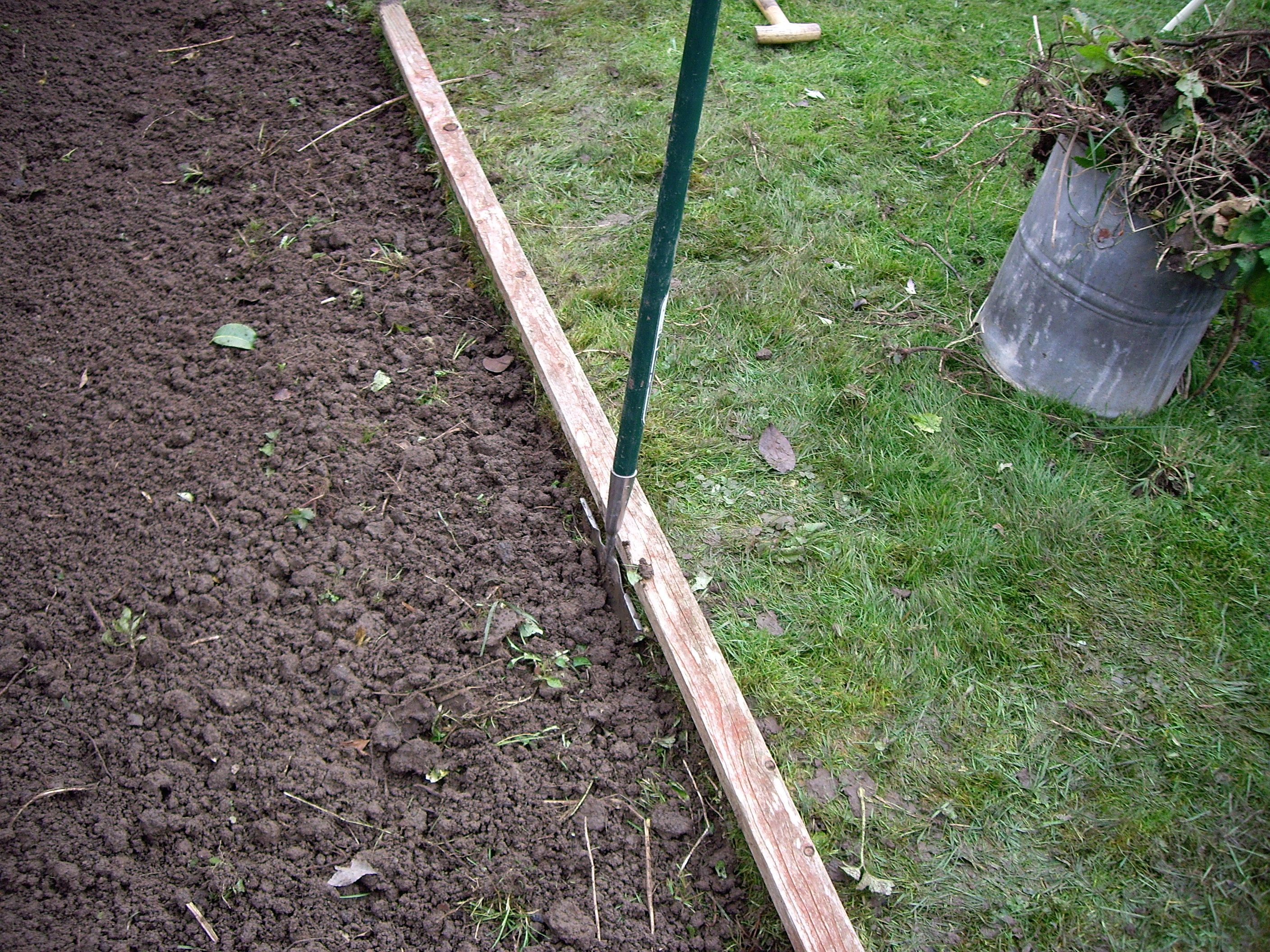 A half moon lawn edger is the ideal tool for this operation but a