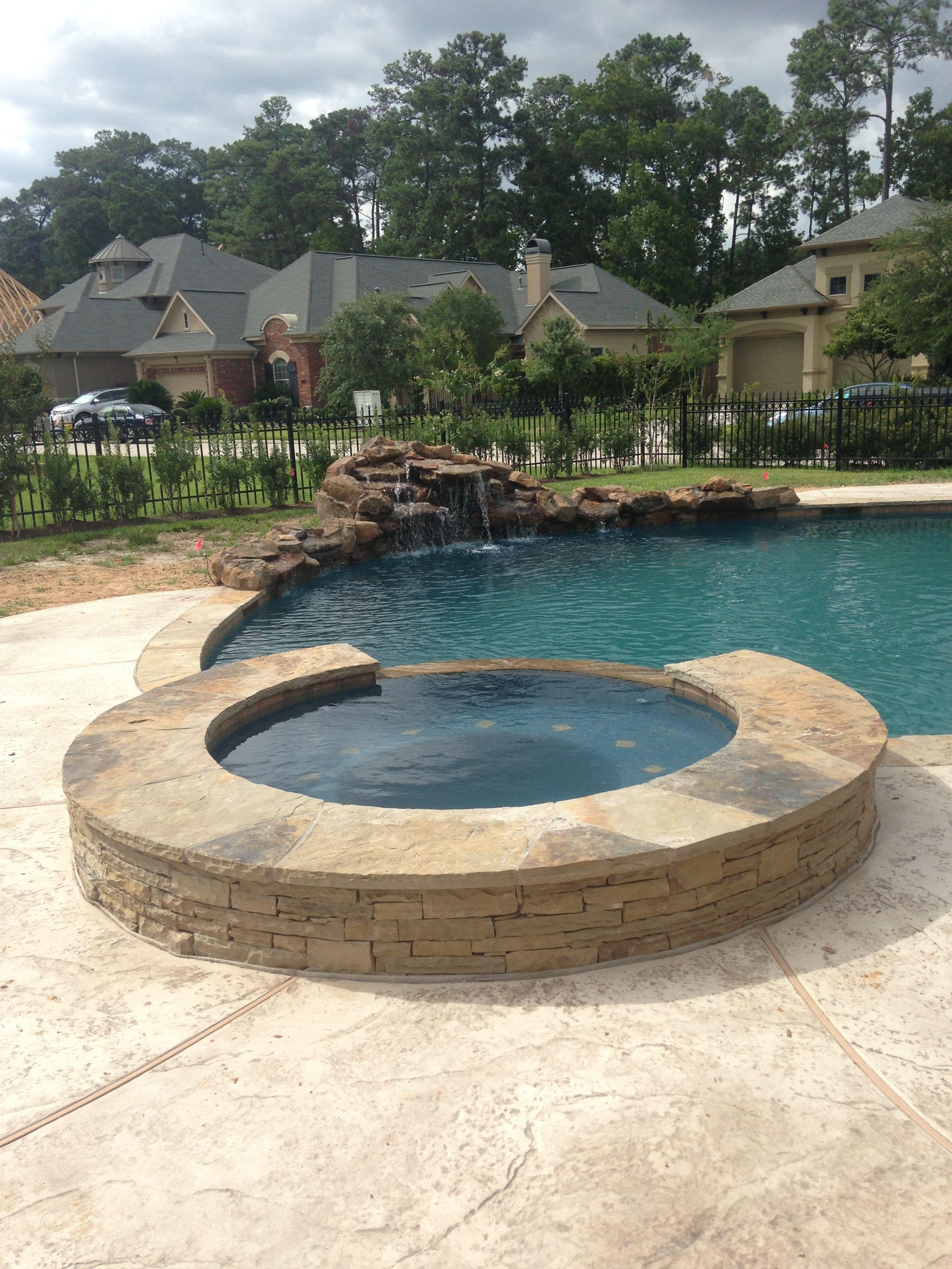 Inground swimming pool Stacked stone raised spa