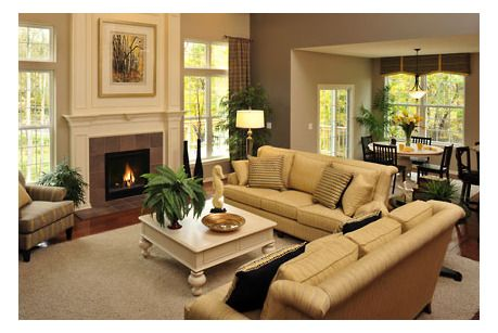 A Fireplace Flanked By Large Windows Is The Focal Point In