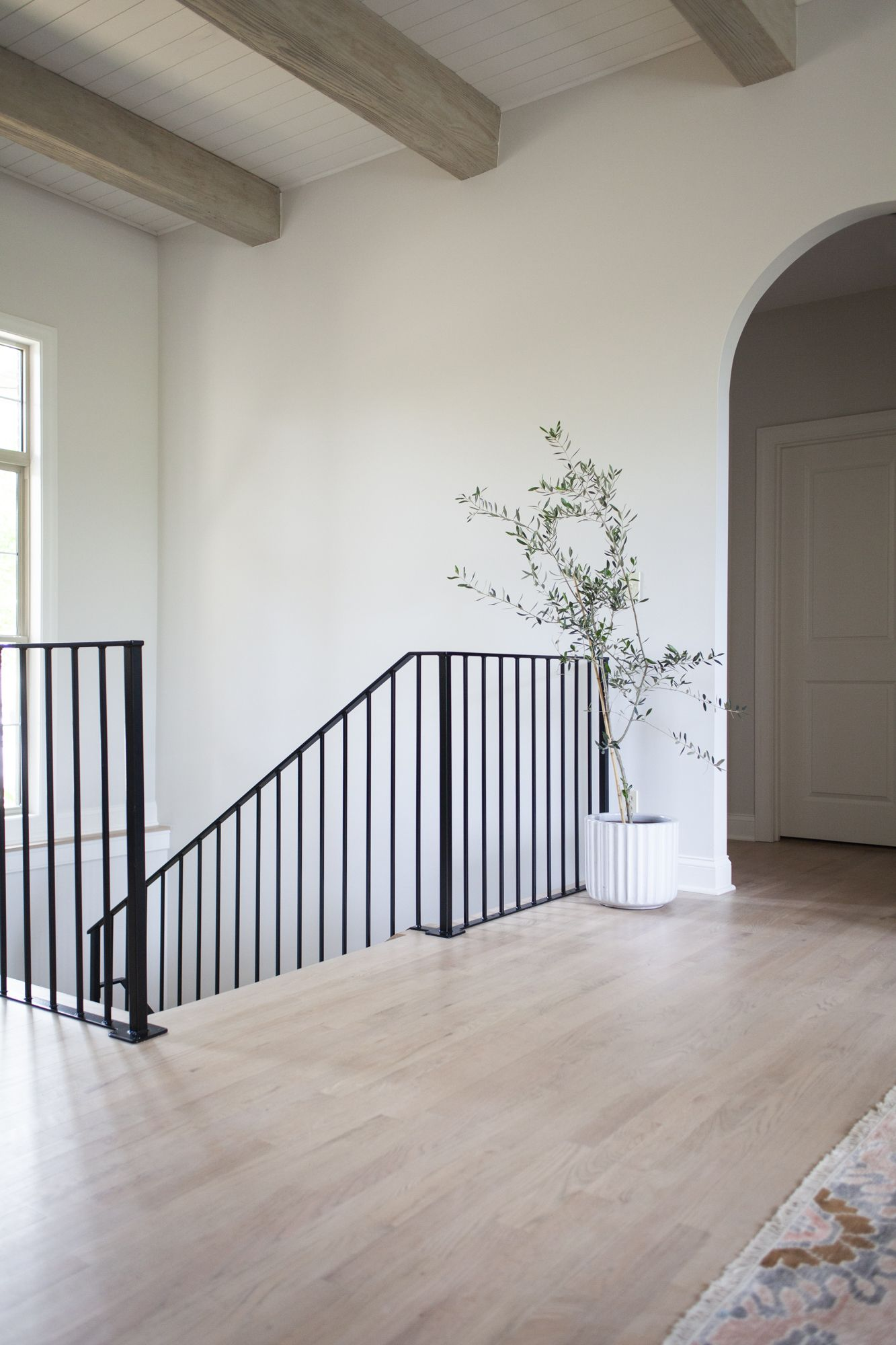 Step by Step Guide to Refinishing Outdated Wood Floors + Cloud White by Benjamin Moore trim color + Classic Gray by Benjamin Moore on the walls   Scout & Nimble