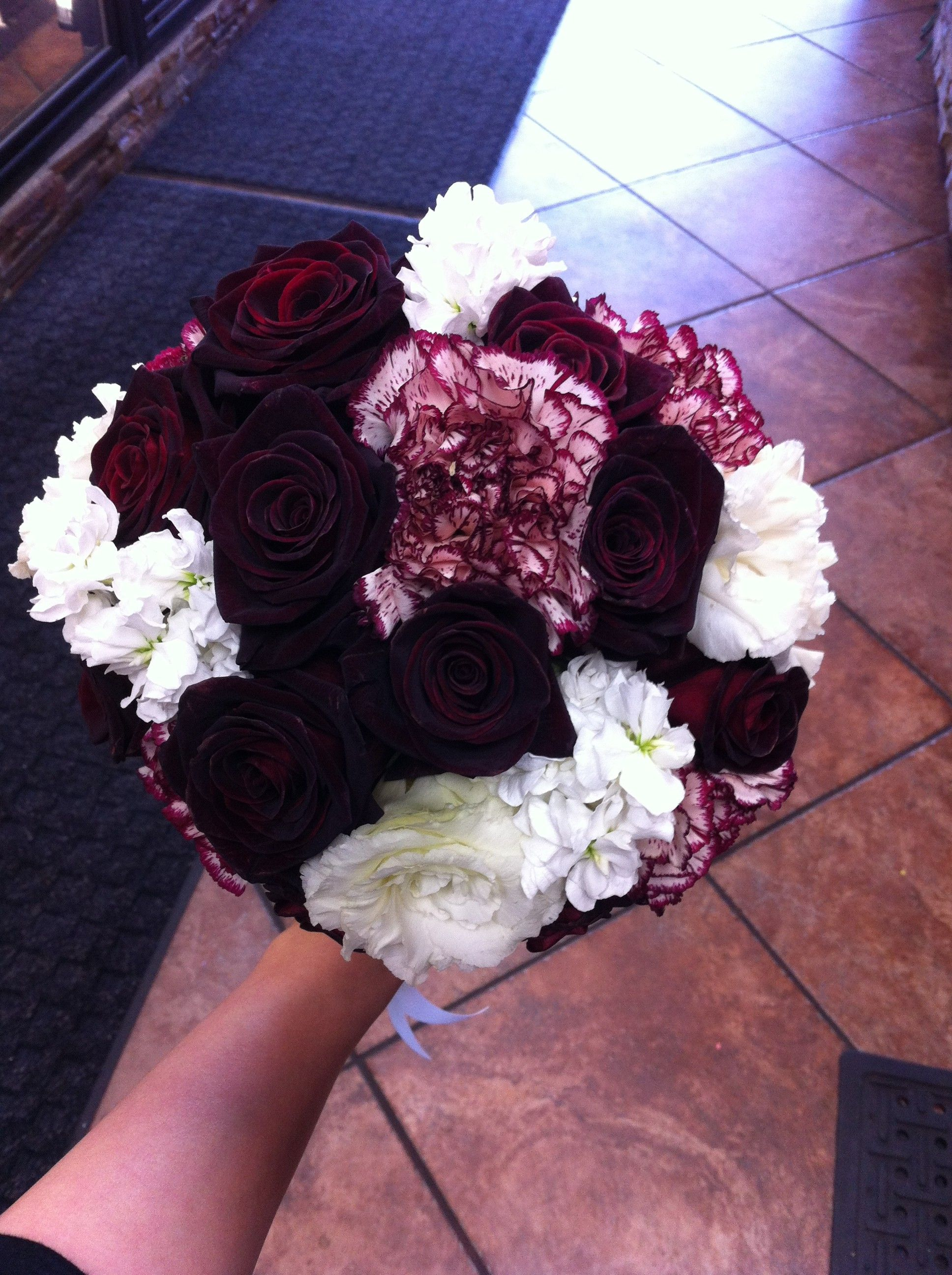 A dark and simple bouquet of burgundy roses peppermint carnations a dark and simple bouquet of burgundy roses peppermint carnations white lisianthus and white stockis product can be ordered in custom colors ie izmirmasajfo